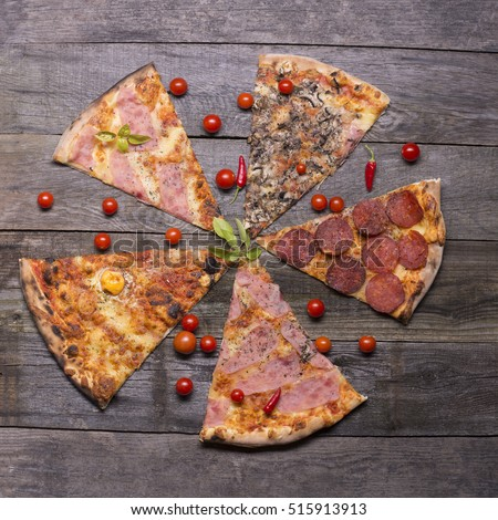 Different pizza parts on table, table top view