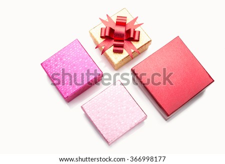Different sizes color gift boxes on white background with some reflection and shadow