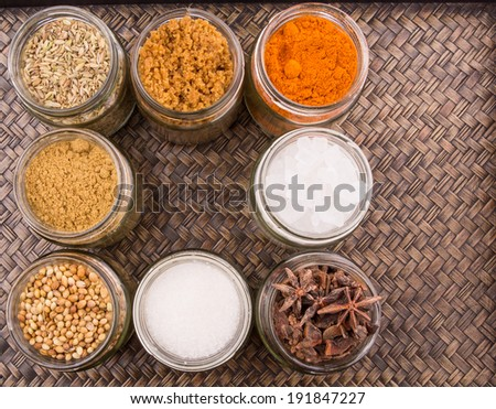 Different variety of sugar and spices over a wicker background