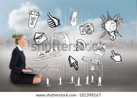 Digital composite of blonde businesswoman sitting using laptop with app icons