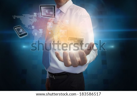 Digital composite of businessman presenting interface with connecting devices