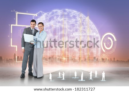 Digital composite of happy business team using laptop with interface