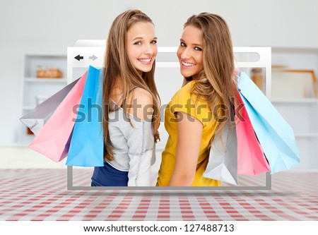 Digital internet window showing girls with shopping bags open on kitchen table