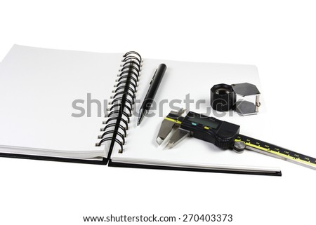 Digital vernier with gem loop, and pen notebook on white
