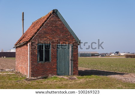 Dilapidated old barn in a Dutch landscape.