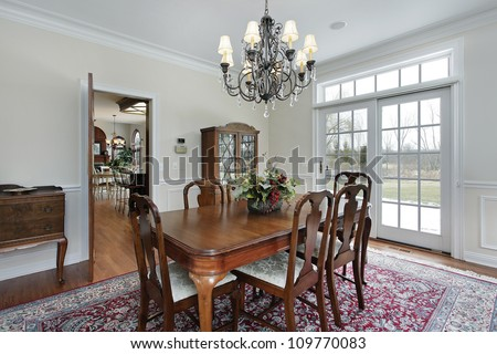 Dining room in suburban home with doors to deck