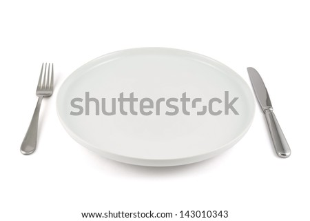 Dinner is served composition: table knife and fork next to the ceramic empty copyspace plate dish isolated over white background