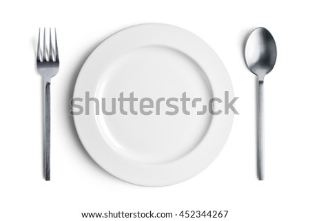 Dinner place setting. A white plate with silver fork and spoon isolated on white background with clipping path