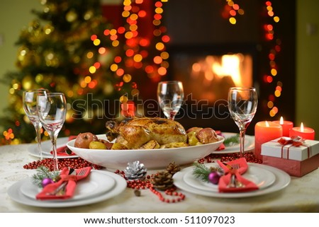 dinner with chicken near Christmas tree and fireplace