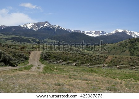 dirt road and fence in back country