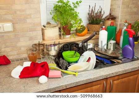 Dirty dishes in the sink after family celebrations. Home cleaning the kitchen. Cluttered dishes in the sink. Housework.