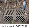 Dirty Storm Drain with Sign - stock
