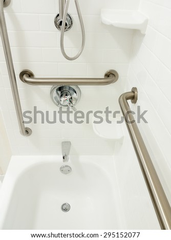 Disabled handicapped shower bathtub with grab bars. Handicapped Access Bathroom Grab Bars Toilet Stock Photo 295152173