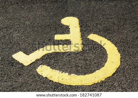 Disabled parking only sign with a wheel chair symbol.