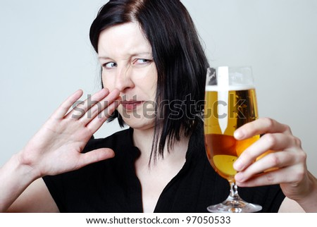 disgusting looking woman with a glass of pilsner