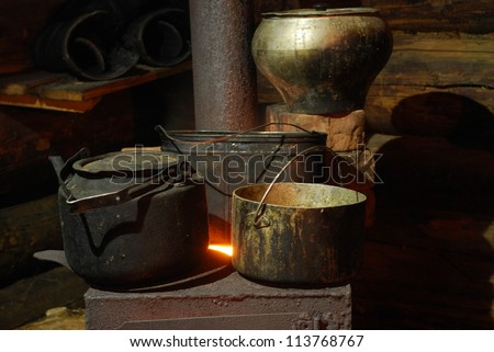 Dishes on the stove on the timbered background