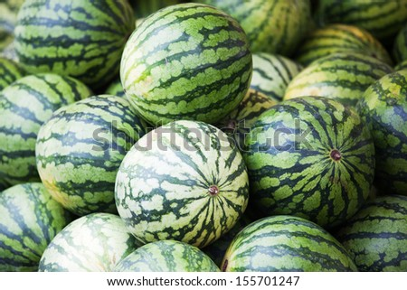 display of a market stall with big melons