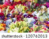 Display of fresh flower arrangements at the farmers market - stock photo