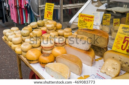 Display of traditional Dutch cheese, like Edam and Leerdam cheese on a table at local market Albert Cuyp, August 13th 2016 Amsterdam, the Netherlands