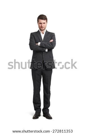 displeased young businessman in formal wear looking down. isolated on white background