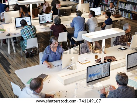 wide angle view busy design office. wide angle view of busy design office with workers at desks. diverse education shoot c