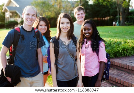 Diverse group of friends walking and smiling