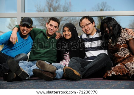 Diverse Group of Students smiling by a window