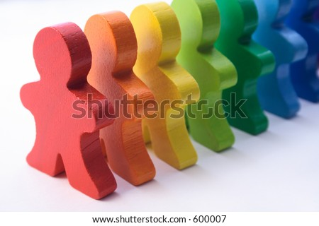Diversity - colorful, wooden people standing in a line.