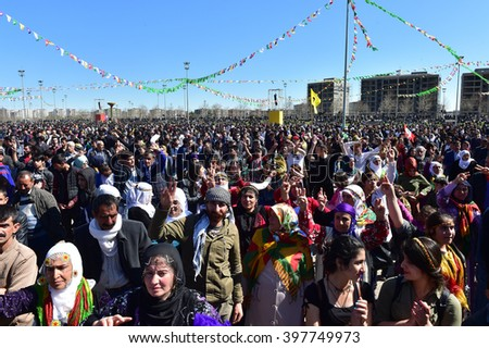 DIYARBAKIR,TURKEY - MARCH 21: Kurds celebrating their traditional feast Newroz that means 'new day' in kurdish on March 21, 2016 in Diyarbakir, Turkey.