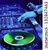 Dj mixes the track in the nightclub at party - stock photo
