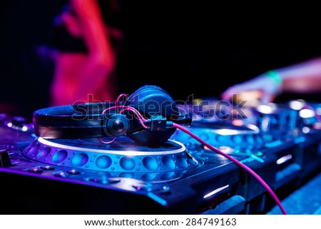 dj playing track nightclub party dj stock photo 89433262 dj mixes the track in the nightclub at party headphones in foreground and dj hands