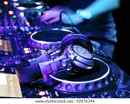 dj mixer headphones nightclub stock photo 105139916 shutterstock dj playing the track in the nightclub at a party dj headphones