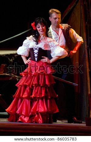 "DNEPROPETROVSK, UKRAINE - JUNE 3: Members of the Dnepropetrovsk State Opera and Ballet Theatre perform "" Carmen "" on June 3, 2011 in Dnepropetrovsk, Ukraine"