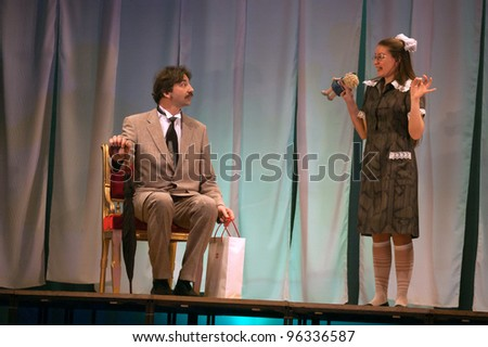 "DNEPROPETROVSK, UKRAINE - MAY 11: Members of the Dnepropetrovsk State Russian Drama Theatre perform ""The man who pays..."" on May 11, 2007 in Dnepropetrovsk, Ukraine"