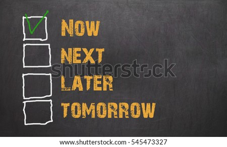Do it now - business concept on blackboard background