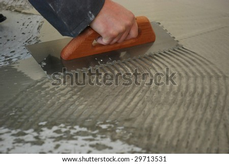 Installing ceramic tile stock photo 51484684 shutterstock do it yourself tile installation dirty work but beautiful when complete solutioingenieria Images