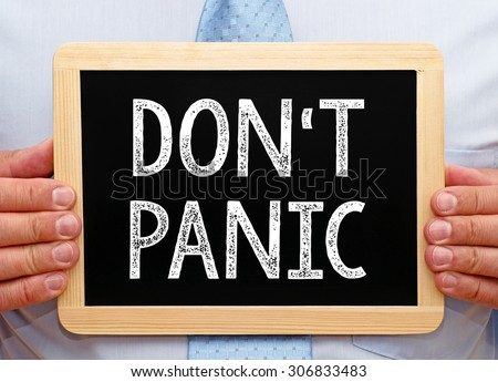 Do not panic - Businessman with chalkboard and text