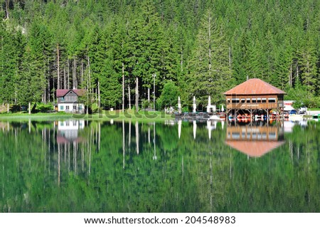 DOBBIACO, ITALY - JULY 12: View of Dobbiaco lake in Veneto, Italy on July 12, 2014. Dobbiaco is a famous lake in Dolomites, province Veneto, Italy.