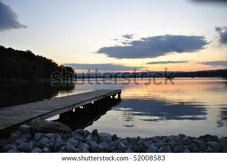 dock in the park at sunset