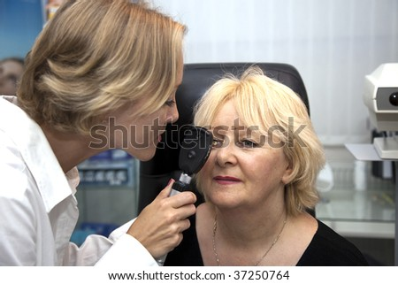 doctor,examining a patient in ophthalmology laboratory