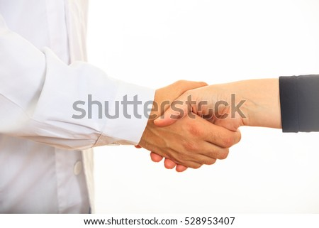 Doctor giving a handshake on white background