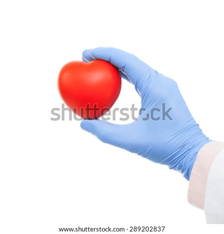Doctor holding heart shaped toy in hand - close up shot