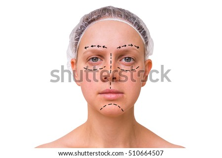 Doctor makes dotted lines on female face for cosmetic face lift - isolated on white background