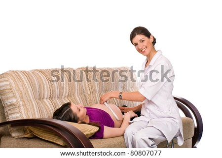 Doctor measuring length of abdomen of pregnant woman on white background