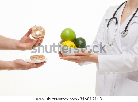 Doctor offering to reject an unhealthy food, white background