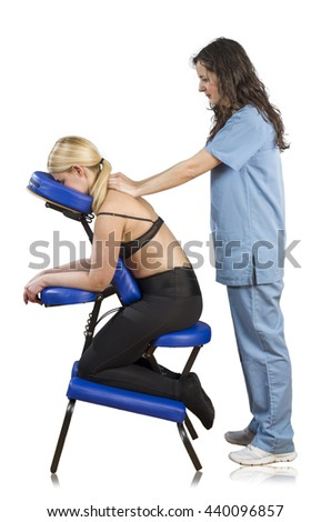 Doctor, physiotherapist examining her patient back and doing decontracting massage.