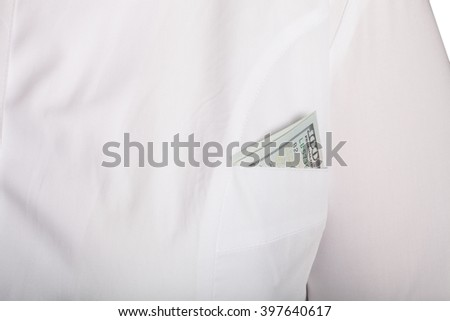 Doctor's pocket with money on a white background.