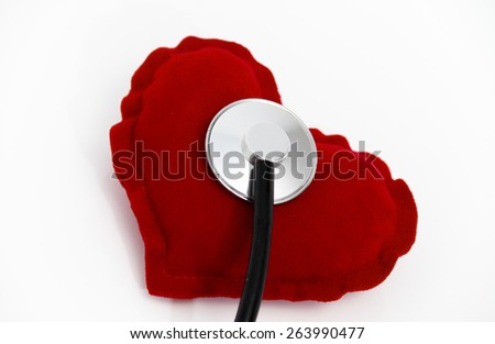 Doctor's stethoscope listening to a healthy red heart, health concept, taking care about health