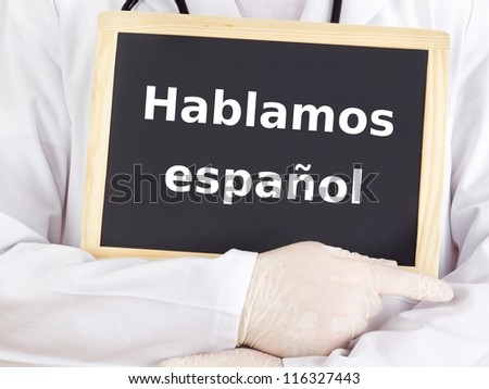 Doctor shows information: we speak spanish