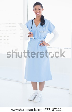Doctor smiling at camera in medical office